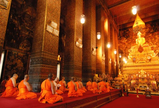Buddha image and monks in Wat Pho Temple, Bangkok, Copyright MJ Prototype