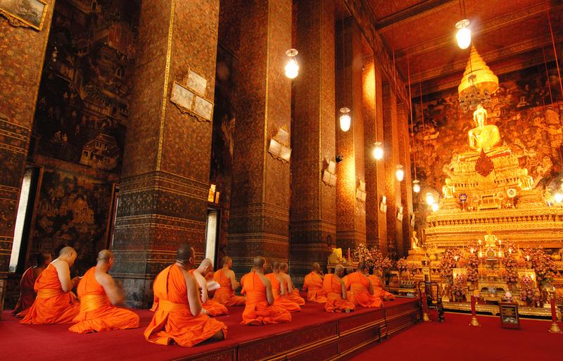 Buddha image and monks in Wat Pho Temple, Bangkok, Copyright MJ Prototype