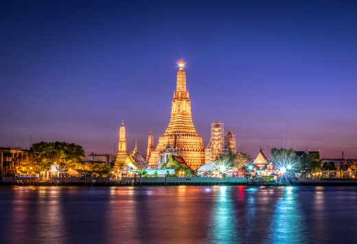 Landscape of Wat Arun at twilight time. A Buddhist temple located along the Chao Phraya river in Bangkok, Copyright 9Tiw