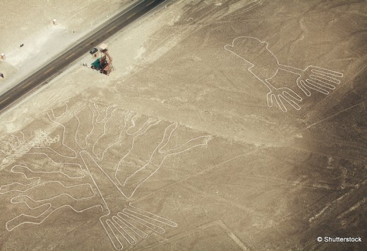 Tree (Arbol) and Hands (Manos) lines in Nazca desert and observation tower near road